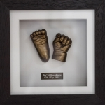 baby hand and foot cast in a frame