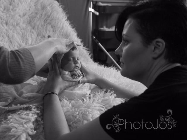 Newborn photographer Kelly Brown demonstrating baby posing