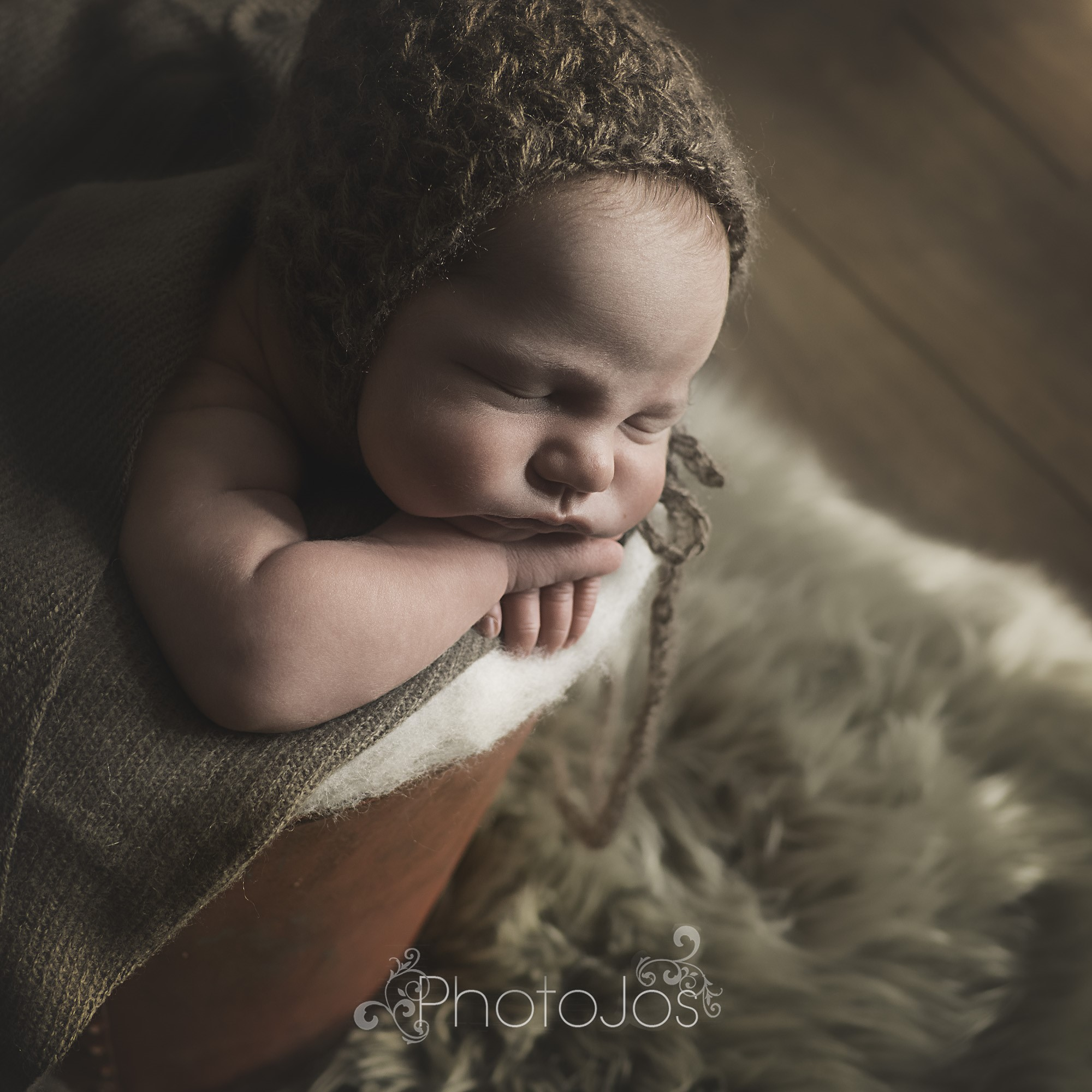 A sleeping baby during the newborn photography training