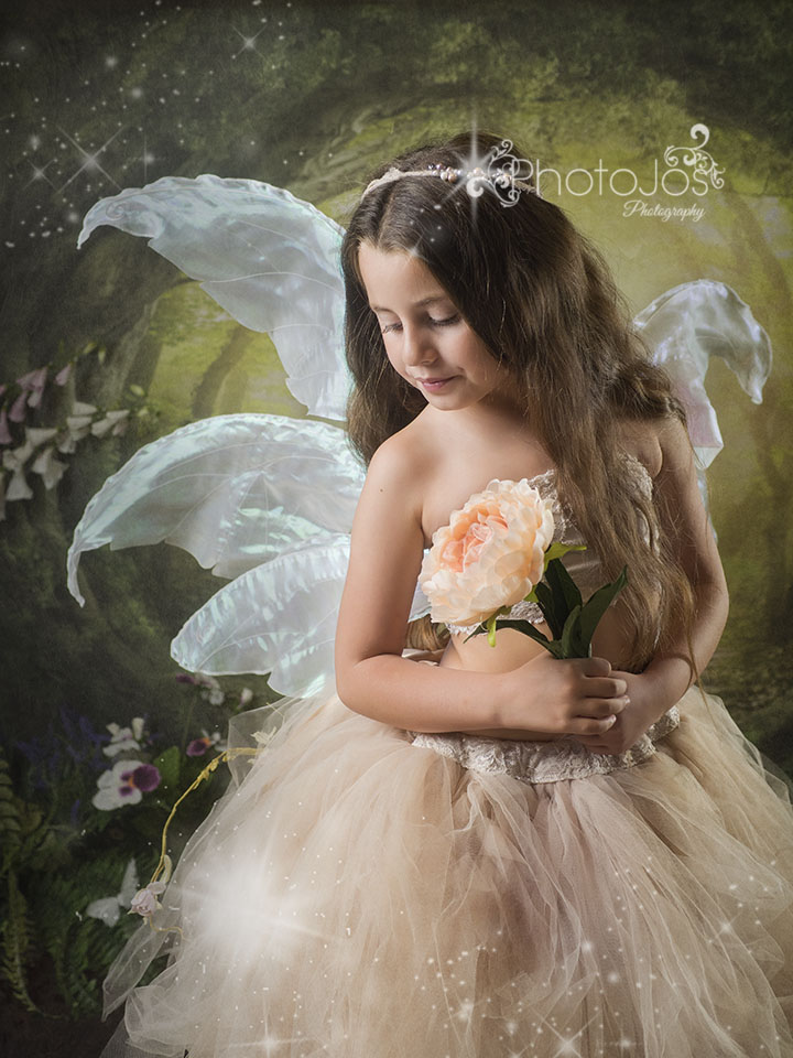 Beautiful fairy in an enchanted adventure photoshoot